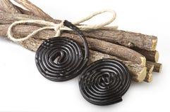 Licorice roots and licorice black Stock Photos