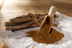 Licorice roots and powder Royalty Free Stock Images