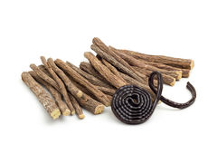 Licorice roots and wheel Royalty Free Stock Image
