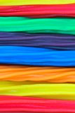 Licorice strands. Background texture of horizontal strands of rainbow colored licorice sticks Stock Photos
