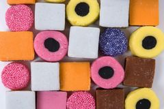 Licorice sweets round and square arranged as a bac Royalty Free Stock Images