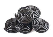 Licorice wheels. On white Stock Image