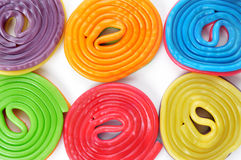Licorice wheels. Some licorice wheels of different colors on a white background stock image