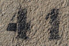 Liczba czterdzieści jeden malujący matrycuje na betonowej ścianie obraz royalty free