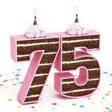 Liczba 75 kształtował czekoladowego urodzinowego tort z zaświecającą świeczką Obrazy Stock