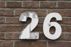 Liczba 26 na ściana z cegieł Fotografia Royalty Free