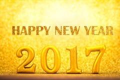 Liczba 2017 umieszczająca na złocistym eleganckim splendoru tle dla nowego ye Fotografia Royalty Free