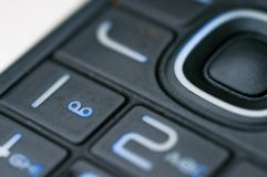 Liczby i listy na starym używać telefonie komórkowym Zdjęcia Royalty Free