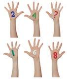 Liczby malować na dziecko rękach Wzrasta up ręki Obraz Royalty Free