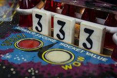 Liczby 3 Opadowi cele na Pinball maszynie Fotografia Stock