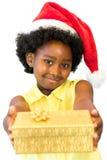 Śliczna afrykańska dziewczyna daje teraźniejszości zdjęcia royalty free