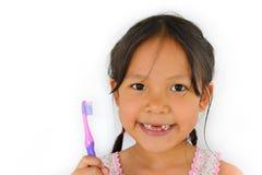 Śliczna azjatykcia dziewczyna i toothbrush Obrazy Royalty Free