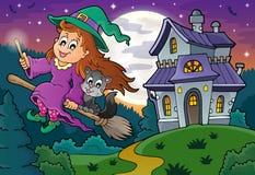 Śliczna czarownica na miotła blisko nawiedzającym domu Obraz Royalty Free