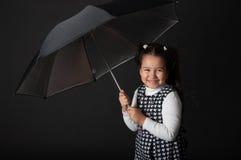Śliczna mała dziewczynka z parasolem Fotografia Stock