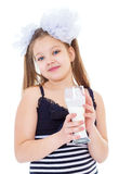 Śliczna mała dziewczynka z szkłem mleko Fotografia Royalty Free