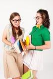 Śliczne nerdy dziewczyny wpadać na siebie w each inny Zdjęcie Royalty Free