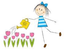 Śliczni dziewczyny podlewania tulipany Zdjęcia Stock