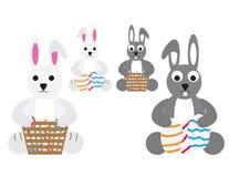 Śliczni Easter króliki z koszami i jajkami Zdjęcie Royalty Free