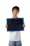 Śliczny dziecka mienia pustego miejsca blackboard obraz royalty free