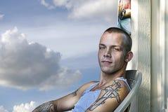 Śliczny Młody facet na ganeczku Fotografia Stock