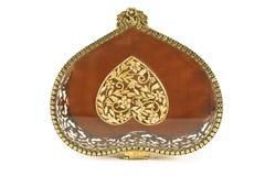 Lid of golden antique jewelry box Stock Photos