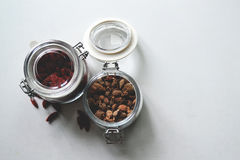 Lid open clamp glass jar with grains. Grains storing in the clamp glass jar with lid open Stock Image