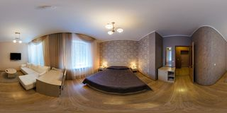 LIDA, BELARUS - MARCH 18, 2012: panorama 360 angle view in small bedroom in hotel in dark style color. Full 360 by 180 degrees stock photos