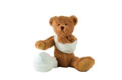Lida den sårada nallebjörnen Royaltyfri Fotografi