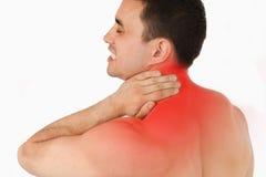 Lidande för den unga mannen från hals smärtar Arkivfoton