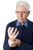Lidande för hög man med artrit Fotografering för Bildbyråer