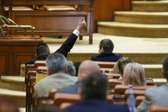 The lider of a parliamentary group signals to his coleagues. BUCAREST, ROMANIA - JULY 4, 2018: The lider of a parliamentary group signals to his coleagues how to royalty free stock photography