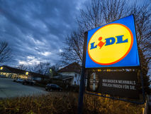 Lidl at dusk. Sign infront of a german Lidl store during dusk - copy space to the left Stock Photos