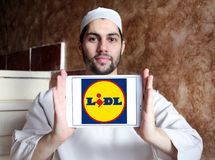 Lidl logo. Logo of the international chain of convenience stores lidl on samsung tablet holded by arab muslim man Royalty Free Stock Photo