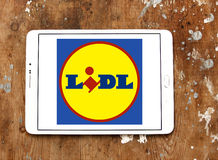 Lidl logo. Logo of the international chain of convenience stores lidl on samsung tablet on wooden background Stock Photography