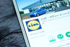 Lidl mobile app. Downloading the international chain of convenience stores lidl from google play store on samsung tablet Royalty Free Stock Images