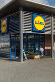 Lidl retail store. Entrance to modern Lidl retail store, one of the biggest retailers in Europe. This store is placed in Hjørring, Denmark Stock Photo