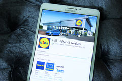 Lidl stores app. Downloading the international chain of convenience stores lidl from google play store on samsung tablet Royalty Free Stock Photos