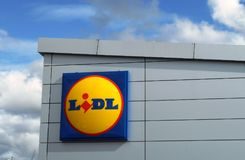 LiDL supermarket sign logo against cloudy blue sky. The LiDL sign logo against a cloudy blue sky on a sunny day Stock Image