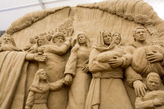 Lido de Jesolo, Italia: Natividad 2016 de la arena: scultures maravillosos de la arena que representan la familia sagrada y el éx imagen de archivo libre de regalías