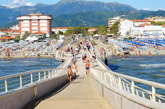 Lido di Camaiore pier. Many people on a pier in Lido di Camaiore, Italy Royalty Free Stock Photos