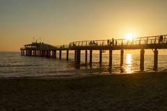 Lido di camaiore pier view on sunset. Amazing lido di camaiore pier view on sunset royalty free stock image
