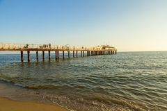 Lido di camaiore pier view on sunset. Amazing lido di camaiore pier view on sunset royalty free stock photography