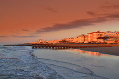 Lido di Jesolo Beach. Hotels by the beach of Lido di Jesolo lighted by the first sun rays -popular resort near Venice,Italy Stock Image