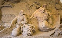 Lido di Jesolo, Italia: Natività 2016 della sabbia: scultures meravigliosi della sabbia che descrivono la famiglia sacra e l'esod Immagini Stock