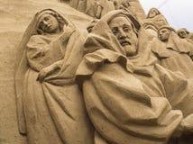 Lido di Jesolo, Italia: Natività 2016 della sabbia: scultures meravigliosi della sabbia che descrivono la famiglia sacra e l'esod Immagine Stock