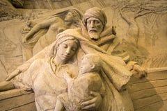 Lido di Jesolo, Italia: Natività 2016 della sabbia: scultures meravigliosi della sabbia che descrivono la famiglia sacra e l'esod Immagini Stock Libere da Diritti