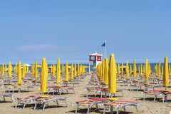 LIDO DI JESOLO, ITALY - May 24, 2019 : Umbrellas on the beach of Lido di Jesolo at adriatic Sea in a beautiful summer day, Italy. On the beach of Lido di royalty free stock photo