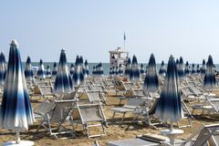 LIDO DI JESOLO, ITALY - May 24, 2019 : Umbrellas on the beach of Lido di Jesolo at adriatic Sea in a beautiful summer day, Italy. On the beach of Lido di stock image