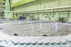 Reactor room. Nuclear reactor lid, equipment maintenance and replacement of the reactor fuel elements. Lids of fuel assemblies of nuclear reactor at the Kursk Stock Images