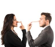 Lie. Concept of lie with couple with long nose Royalty Free Stock Photos
